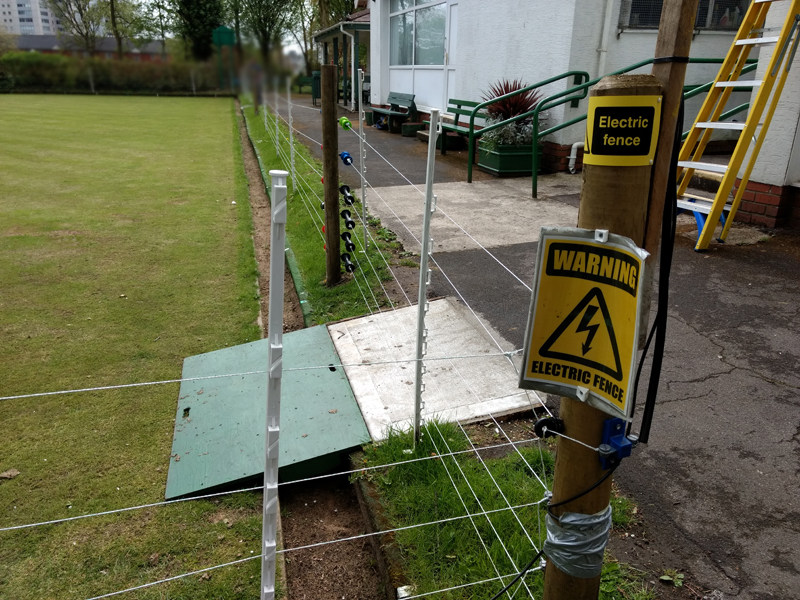 Electric fence around a bowling green.