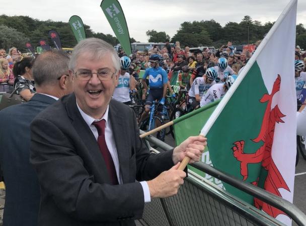 Mark Drakeford holds Welsh flag